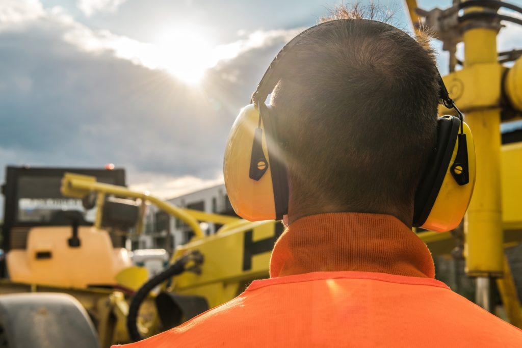 man wearing hearing protection gear at jobsite